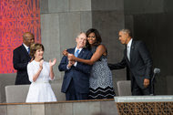 Michelle Obama hugged George W. Bush on Saturday at the National Museum of African American History and Culture.