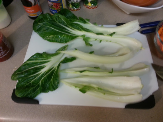 The Bok Choy is cut with first cutting out the white part. Then chop up the greens into 1 inch pieces.