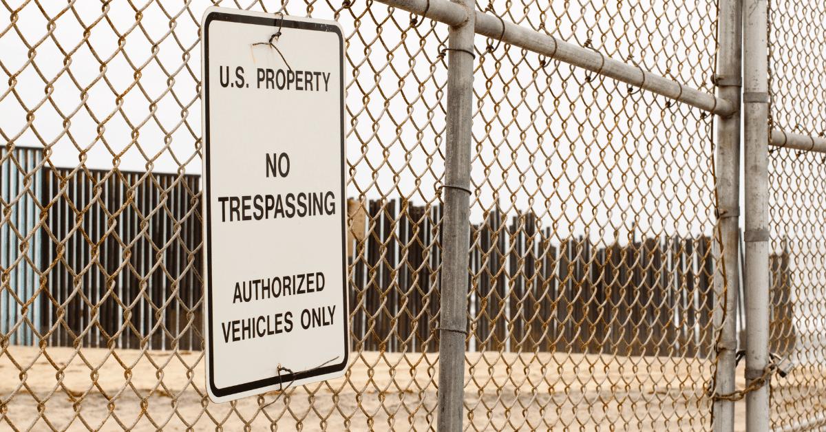 No Trespassing sign at the US-Mexico border