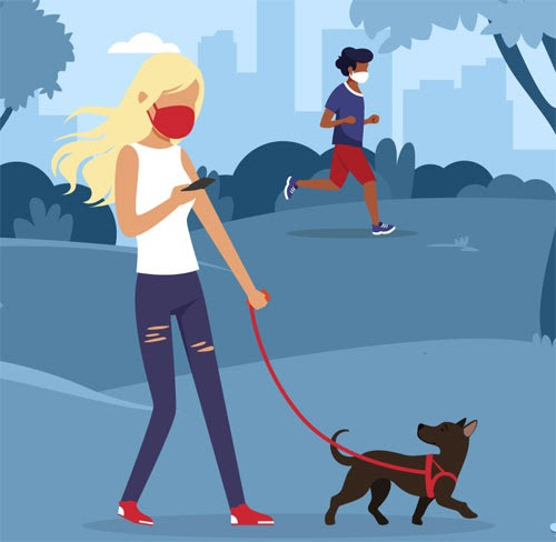 Teen with mask walking dog in park and teen running in background