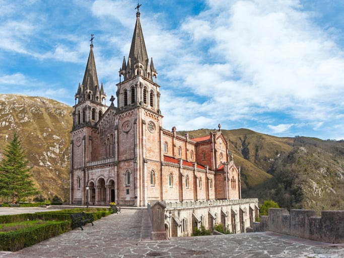 Our Lady                                                           of Covadonga                                                           Cathedral in                                                           northwest                                                           Spain is                                                           notable for                                                           its slight                                                           pink                                                           coloration                                                           from the pink                                                             marble                                                           excavated from                                                           the                                                           surrounding                                                           mountains.