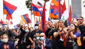 Armenians, their descendants and supporters rally to commemorate the 106th anniversary of the Armenian genocide in Los Angeles, California, yesterday.