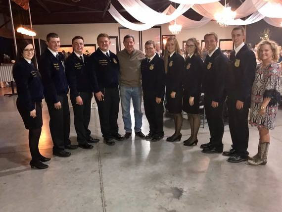 State Superintendent Jillian Balow and U.S. Senator John Barrasso with Wyoming's FFA State Officer Team at a fundraising event.