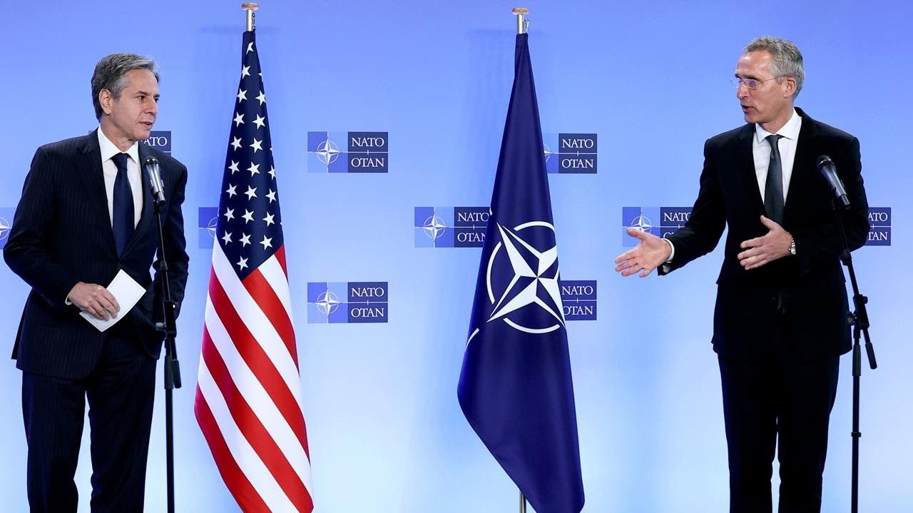 NATO Secretary General Jens Stoltenberg (R) and US Secretary of State Antony Blinken address a media conference at NATO headquarters in Brussels, April 14, 2021.