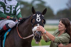 Kathleen O'Connell greets Well Defined upon his return from winning the Sam F. Davis Stakes at Tampa Bay Downs