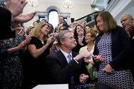 Massachusetts Gov. Charlie Baker with State Treasurer Deborah Goldberg after he signed the salary bill into law on Monday.