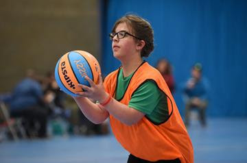 A young woman with a basketball