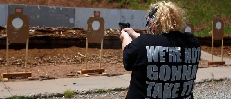 Mallory Washburn shoots at targets. Gun violence has remained in the forefront of national conversation since the Orlando shootings. REUTERS/Jim Urquhart