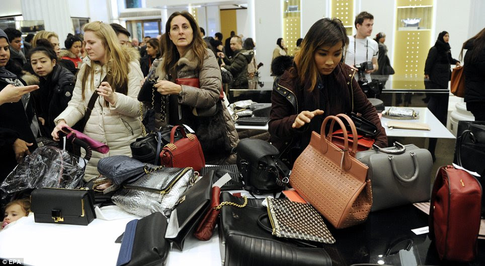 Luxury: Shoppers snapped up pricey handbags and other high-end items which had been heavily discounted