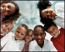 The figure above is a photograph showing a group of school children.