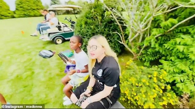 Style:The hitmaker cut a casual figure for the family outing as she sported a black T-shirt with a pair of matching trousers