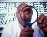 Photograph of a male doctor looking through a magnifying glass