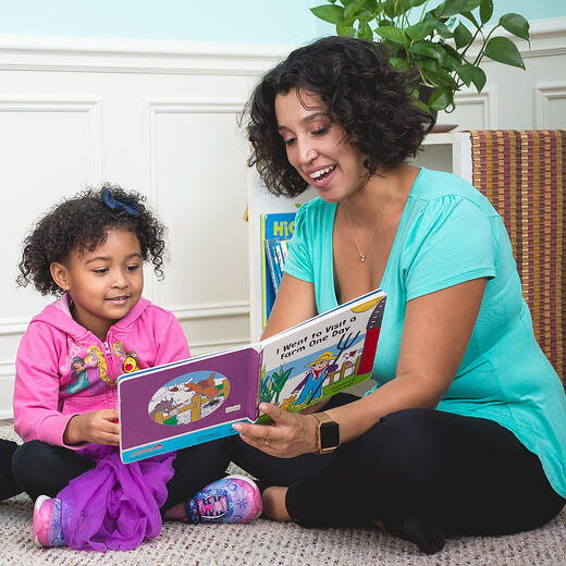 Mom and daughter reading aloud.