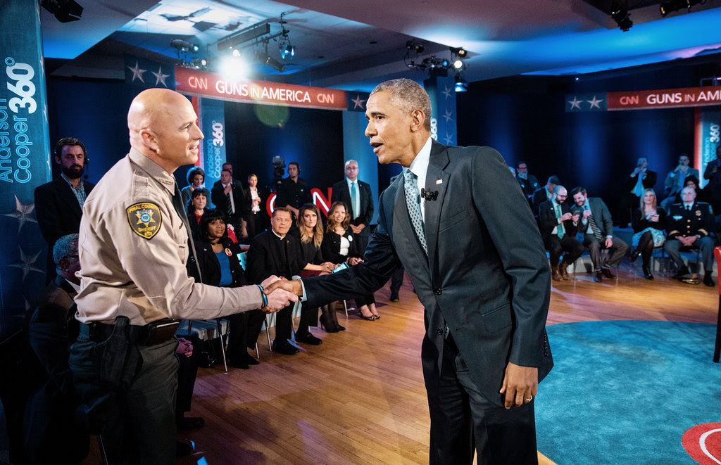 President Obama greeted a sheriff who asked a question during a town-hall-style meeting in Fairfax, Va., on Thursday.