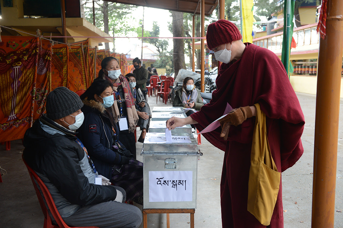 An exile Tibetan monk casts his vote in the preliminary round of elections to choose a new Sikyong and members of the Parliament at a polling station in McLeod Ganj, India, on 3 January 2021.