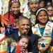 President Obama posed with American Indian children at a Flag Day event last month in North Dakota. He pledged to help develop the economy among tribes.