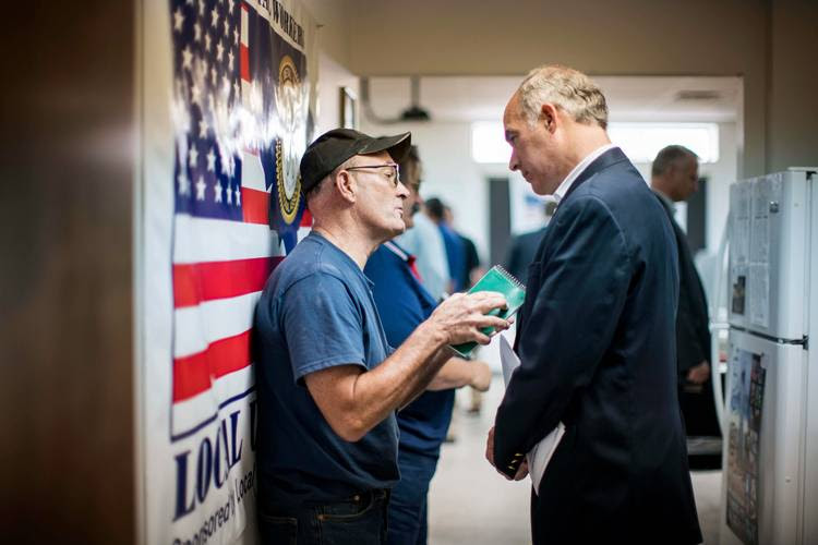 Sen. Bob Casey (D-Pa.) talks to a union member in Wilkes Barre after a meeting with Sheet Metal Workers Local 44. (Melina Mara/The Washington Post)