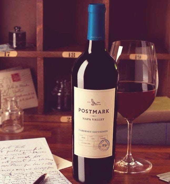Bottle and glass of  Postmark Cabernet Sauvignon Napa Valley by Duckhorn 2018 on library table