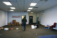 Martin O'Malley's New Hampshire state director in what remained of the campaign office in the closed Manchester, N.H., on Thursday.