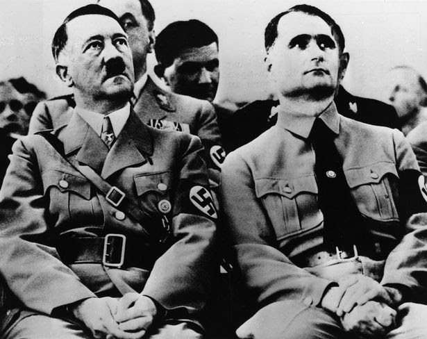 Adolf Hitler (1889 - 1945) with his deputy and private secretary, Rudolf Hess (1894 - 1987) at a Nazi Party meeting