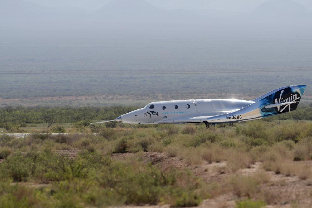 The Virgin Galactic rocket plane, with founder Richard Branson and other crew members on board, lands back in Spaceport America near Truth or Consequences, N.M., Sunday, July 11, 2021. (AP Photo/Andres Leighton)