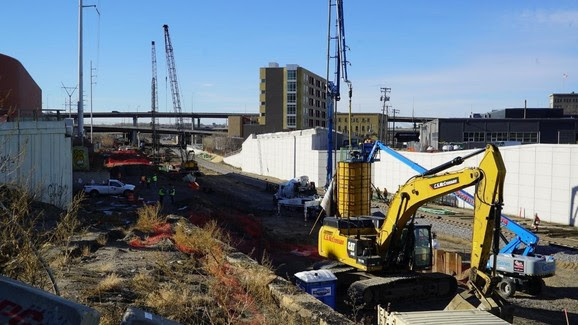 Glenwood Avenue roadway and LRT bridge: ongoing piling and bridge structure construction.
