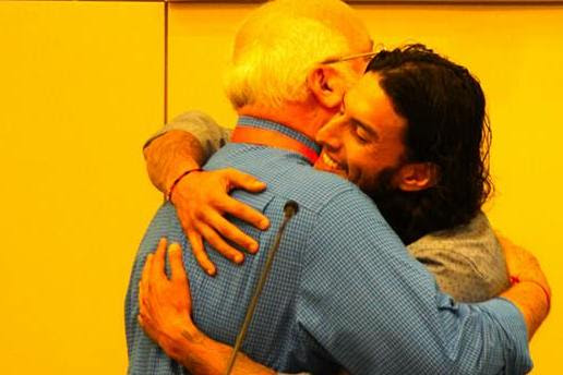 photo: Father G and Richard Cabral embrace