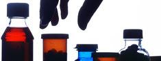 Hand reaching for pill bottle
