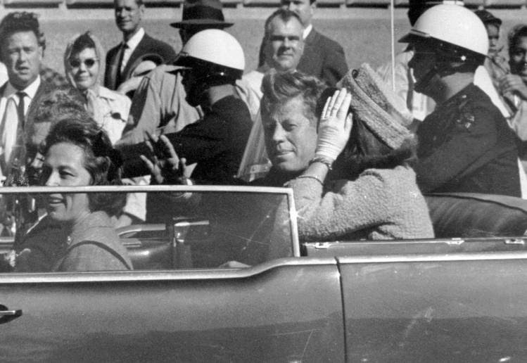 John F. Kennedy waves from his car in Dallas shorly before being killed on Nov. 22, 1963. (Jim Altgens/Associated Press)