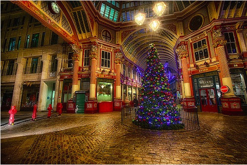 impressive Leadenhall Market in London, which has been around since the 14th century, is decorated with Christmas trees and tinsel to get shoppers in the holiday spirit