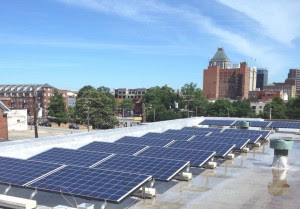 Duke Energy wants to smack down NC WARN for setting up a small experimental solar project on the rooftop of Greensboro's Faith Community Church to test a state law prohibiting third-party electricity sales in North Carolina. Photo by NC WARN