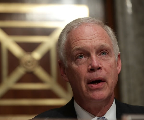 ron johnson speaks at a hearing