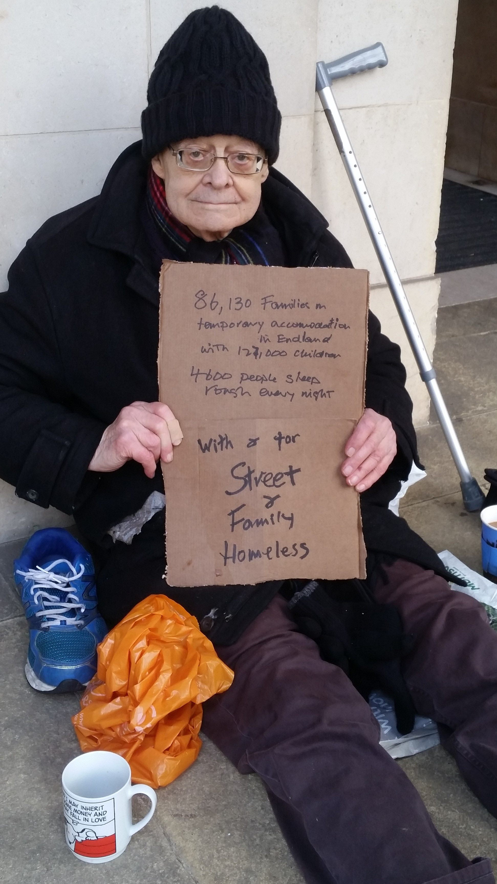 A picture of Rev Paul begging in front of Church House for the street and family homeless