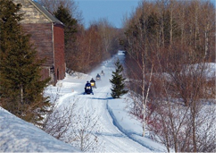 Snowmobiles on a trail in Maine