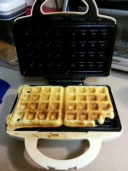 The waffle is golden brown.