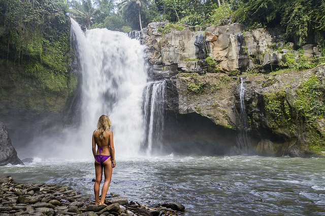 Young woman at Tegenungan Waterfall near Ubud