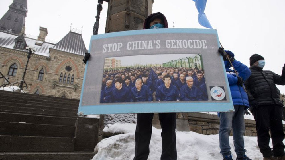 Protesters gather outside the Parliament buildings in Ottawa, Ontario, Monday, Feb. 22, 2021.