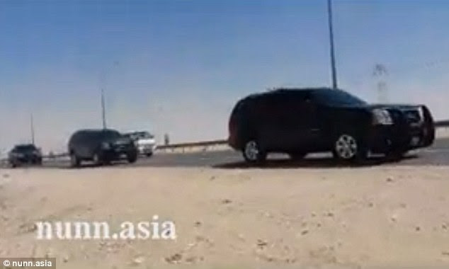 Convoy: The prisoners pull up in a convoy of black SUVs, pictured