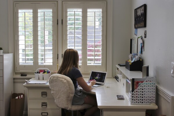 Maddi Dale focuses on her remote French class in her bedroom in Lake Oswego, Ore., on Oct. 30, 2020.