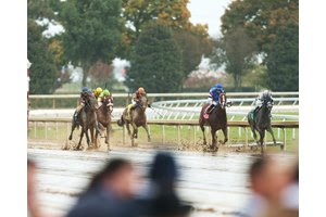 Horses race to the finish during the fall meet at Keeneland
