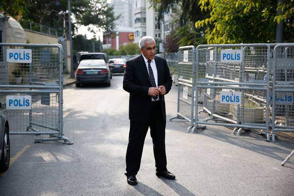 A security guard stands on a blocked road, leading to the Saudi Arabia consulate in Istanbul, onOct. 3.(Lefteris Pitarakis/Associated Press)</p>
