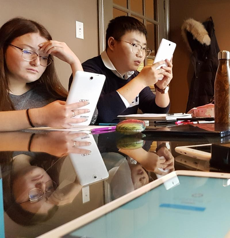 LLI Students usng new tablets for testing