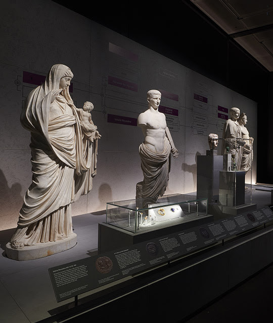 Inside 'Nero: the man behind the myth' showing marble sculptures of people on display. A family tree of Nero can be seen behind.