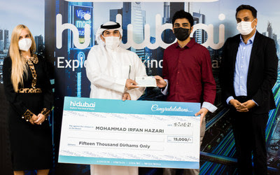 First Prize winner Mohammed Irfan Hazari receiving the cheque from Dubai Economy Official Mr.Yousef Al Shebani