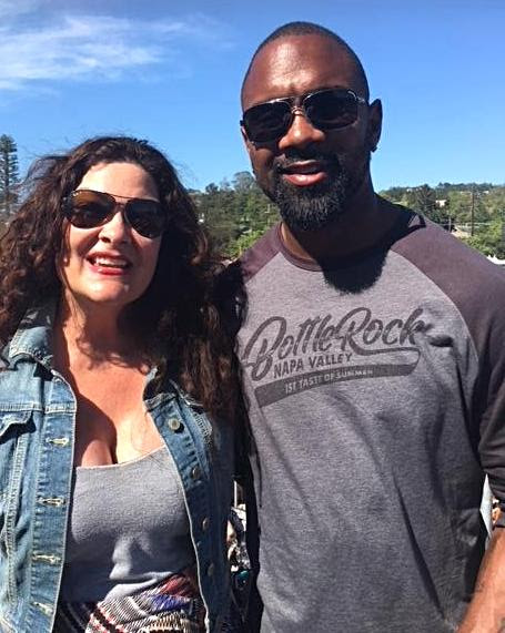 Gena Pasquini with Charles Woodson of the Raiders _previously the Packers_