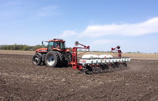 tractor planting in field