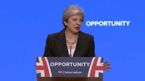 Theresa May speaking at Conference
