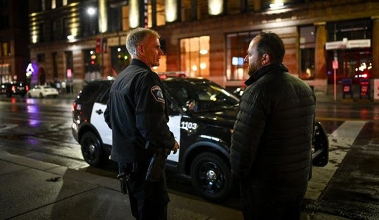 Council Member Fletcher downtown with Minneapolis police officer