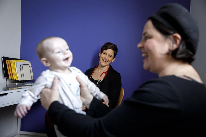 Elizabeth Brandeis, centre, a midwife and president of the Association of Ontario Midwives, is shown with fellow midwife, Simone Rosenberg, holding baby Jascha, on Friday.