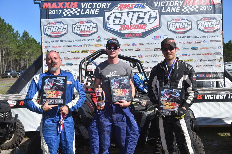 Single Seat UTV Overall Podium: (2) Chris Ferraro, (1) Collin Truett, (3) Robert Boynton.